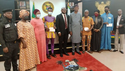 Chief of Staff to Gov. Sanwo-Olu of Lagos, Mr Tayo Ayinde, 5th from left; DCP Tunde Disu, a  former RRS Commander, 1st from left and families of deceased policemen at the Government House, Alausa-Ikeja, during the presentation of cheques to families of three deceased policemen who died in the course of their duties in the state , on Wednesday July 28, 2021 (NAN).