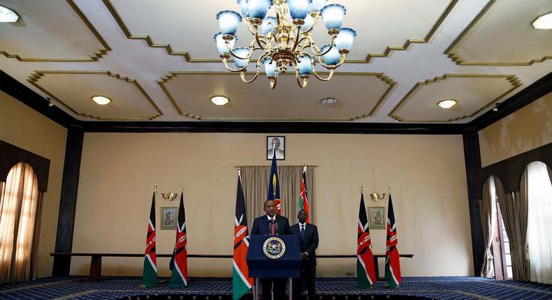 Kenya's President Uhuru Kenyatta (front) and his Deputy William Ruto deliver a statement to members of the media at the State House in Nairobi, Kenya September 21, 2017.