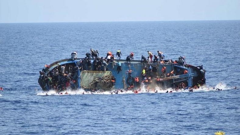"Migrants are seen on a capsizing boat before a rescue operation by Italian navy ships ""Bettica"" and ""Bergamini"" off the coast of Libya in this handout picture released by the Italian Marina Militare on May 25, 2016."