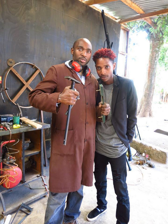 Paul Kihuha (also known as Protisa) with comedian Erick Omondi at his workshop.