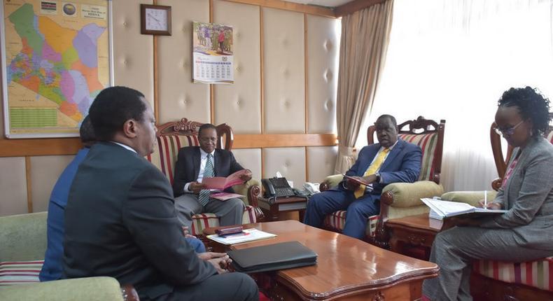 Dr Fred Matiang'i with PS Karanja Kibicho, BCLB Chairman Cyrus Maina, and CEO Liti Wambua