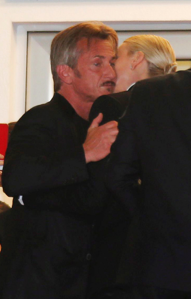 "Actor and director Sean Penn and actress Charlize Theron kiss as they leave after the screening of the film ""The Last Face"" in competition at the 69th Cannes Film Festival in Cannes"