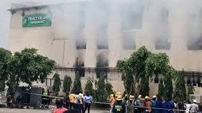 Lady seen setting Ebeano supermarket on fire in Abuja