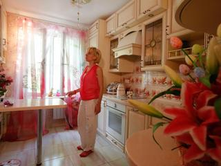 Anti-demolition activist Kari Guggenberger shows the kitchen of her apartment in a building to be de