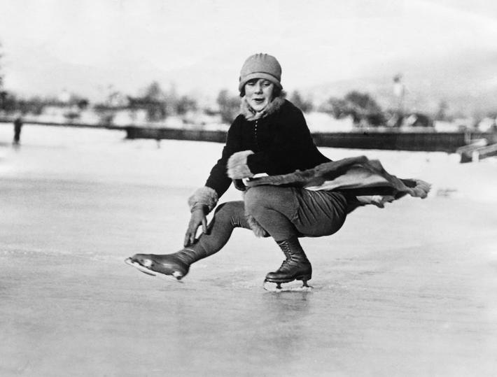 Sonja Henie in Crouching Position While Skating