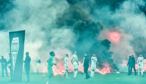 Under fire:Saint-Etienne and Angers players swathed in smoke as kick off was delayed in their Ligue 1 game Creator: PHILIPPE DESMAZES