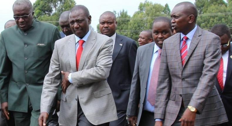 File image of Oscar Sudi with DP Ruto and other leaders at a public event