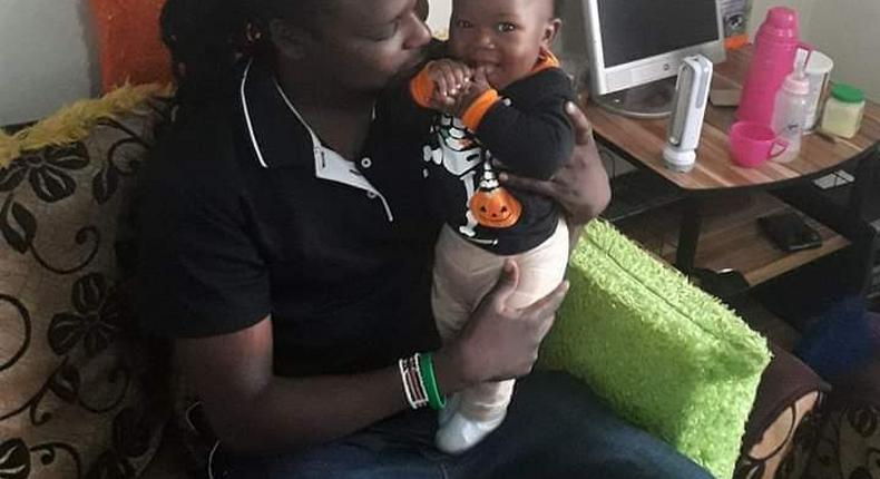 Baby Ethan Muendo with his father, KBC journalist Jonathan Muendo (Twitter)