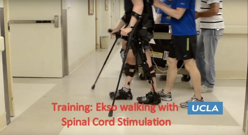 Screenshot of Mark Pollock using the robotic exoskeleton to walk