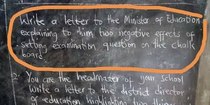 Teachers write exam questions on chalkboards