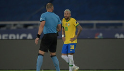 Argentine referee Nestor Pitana, left, speaks with Brazil's Neymar during the Copa America football tournament group phase match between Brazil and Colombia on Wednesday in Rio de Janeiro Creator: CARL DE SOUZA