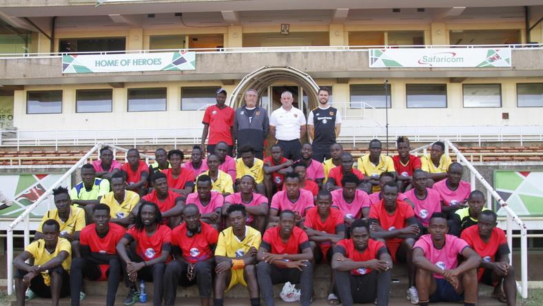 The players who went through the first phase of the camp pose with Harambee Stars Head Coach Stanley Okumbi, Development Coach Terry Boyle, Hull City legend Dean Windass, and Partnerships Executive Andrew Stead.