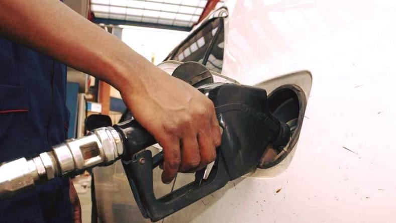 An attendant pumps fuel into a car