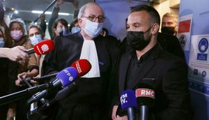 French football player Mathieu Valbuena (R), involved in a 'sex tape case', addresses media representatives next to lawyer Paul Albert Iweins (C) inside a court Creator: Thomas SAMSON