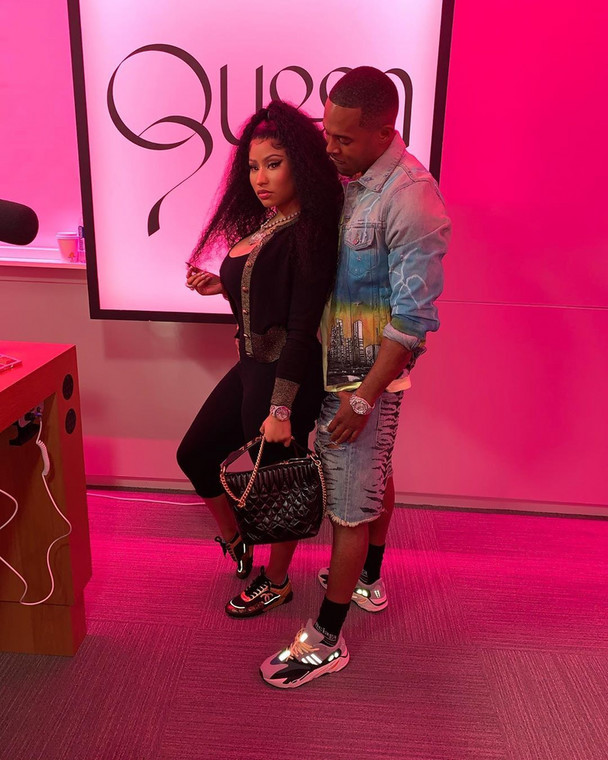 """=Nicki and Kenneth were trying to keep a low profile inside the courthouse as they waited in line at the window that read, """"marriage licenses and ceremony appts. ONLY"""" ... and Kenneth paid for the license before they left.[Instagram/NickiMinaj]"""