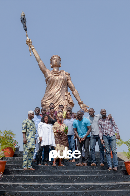The cast, crew of Queen Moremi - The Musical and me at the Moremi statue