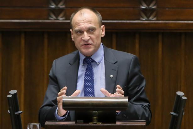Lider Ruchu Kukiz'15 Paweł Kukiz przemawia podczas debaty nad expose w Sejmie.