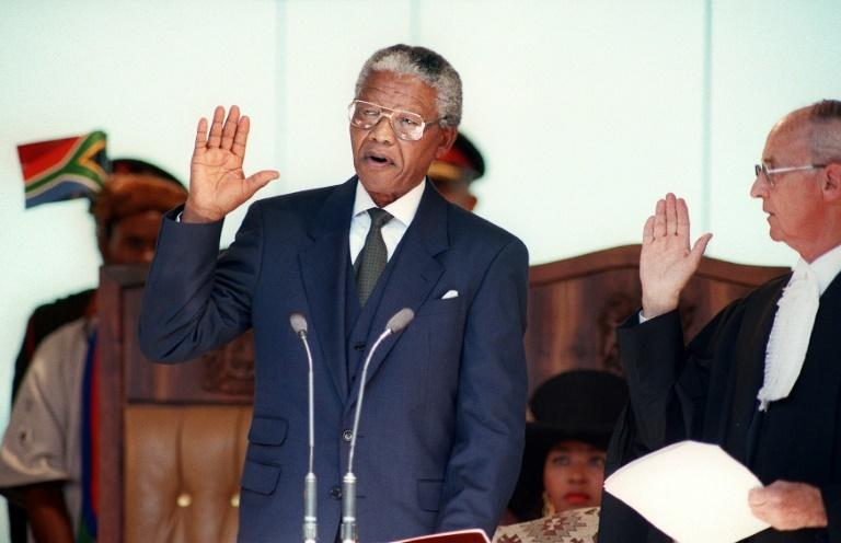Nelson Mandela took oath as South Africa's first black president in May 1994