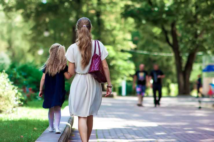 stock-photo-rear-view-of-young-mother-walking-with-little-girl-daughter-in-beautiful-summer-park-wearing-1127107679
