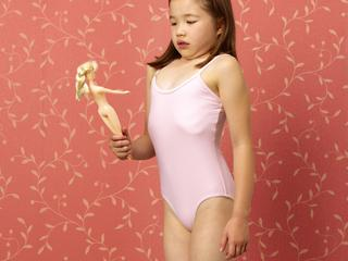 Young girl mimicking dolls figure
