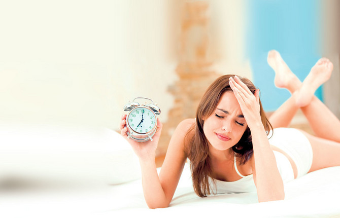 12197_stock-photo-young-woman-with-alarm-clock-on-the-bed-at-the-morning-shutterstock_16209115