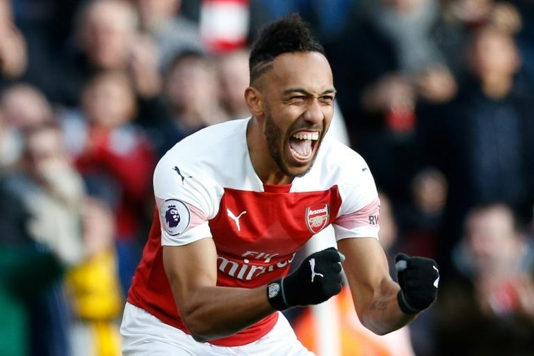 Top of the charts: Pierre-Emerick Aubameyang is the Premier League's top scorer on 12 after scoring twice against Burnley