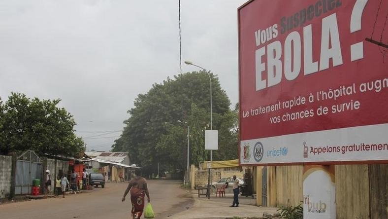 A billboard with a message about Ebola is seen on a street in Conakry, Guinea in this October 26, 2014 file photo. REUTERS/Michelle Nichols