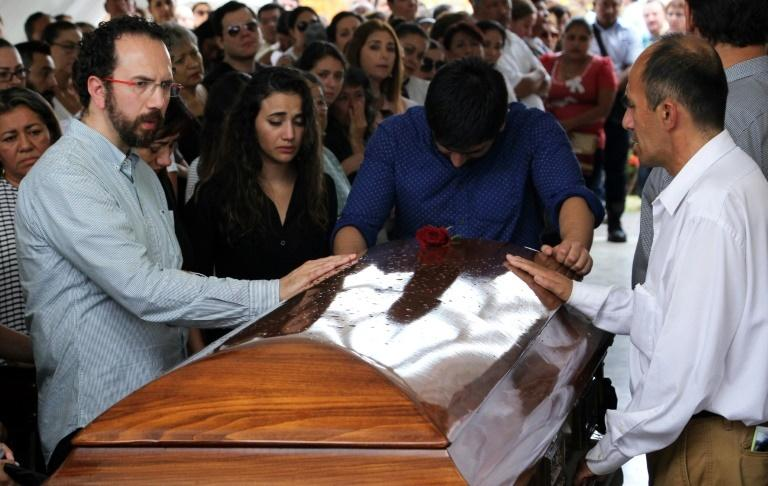 Mourners surround the casket of Mexican radio journalist Juan Carlos Huerta, shot dead in May 2018 in Tabasco state - the same state where radio journalist Jesus Ramos Rodriguez was killed in February 2019