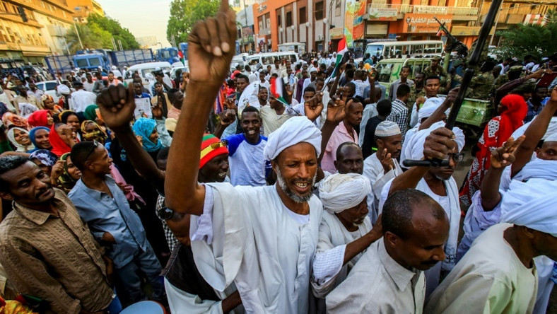 Sudanese supporters of the ruling military council rallied in central Khartoum on Friday
