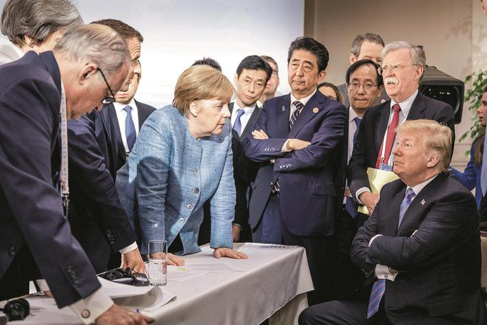 German Chancellor Merkel speaks to U.S. President Trump during the second day of the G7 meeting in C