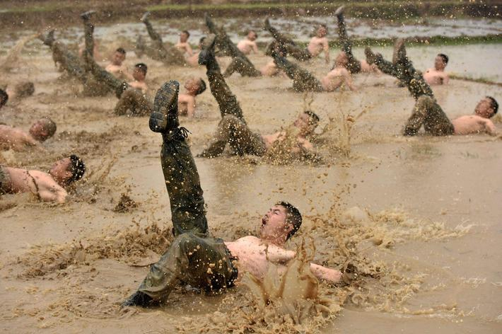 Paramilitary policemen attend a training session in Guigang