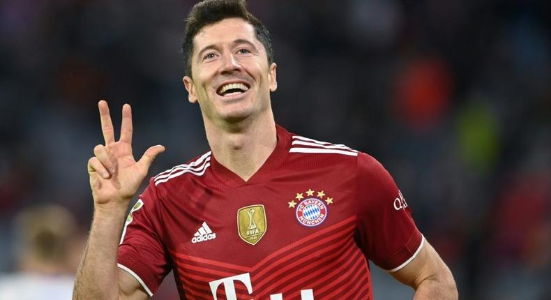Robert Lewandowski celebrates his hat-trick as Bayern Munich thrashed Hertha Berlin 5-0 on Saturday Creator: CHRISTOF STACHE