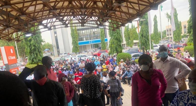 Customers crowd a bank entrance in Lagos on May 4, 2020