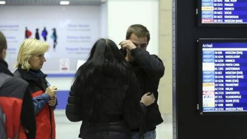 "A man reacts next to Russian Emergencies Ministry members at Pulkovo airport in St. Petersburg, Russia, October 31, 2015. A Russian airliner carrying 224 passengers and crew crashed in Egypt""s Sinai peninsula on Saturday, the Egyptian civil aviation authority said, and a security officer who arrived at the scene said most of the passengers appeared to have been killed."