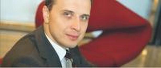 Michał Grzybowski, doradca podatkowy, dyrektor w Ernst & Young Fot. Wojciech Górski