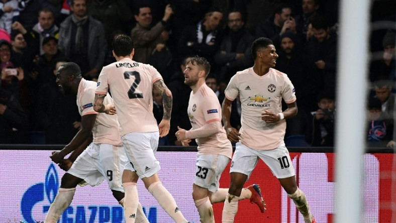 Marcus Rashford celebrates with his teammates after his last-gasp VAR-awarded penalty took Manchester United through at PSG's expense