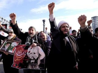 Iranian protesters chant slogans during a demonstration against the execution of Shi'ite cleric Shei