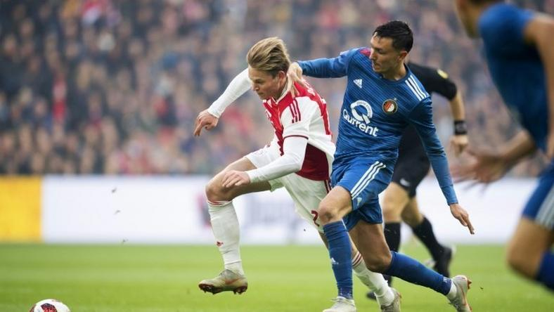 Ajax and Netherlands star Frenkie de Jong (L) in action against Feyenoord's Steven Berghuis (R).