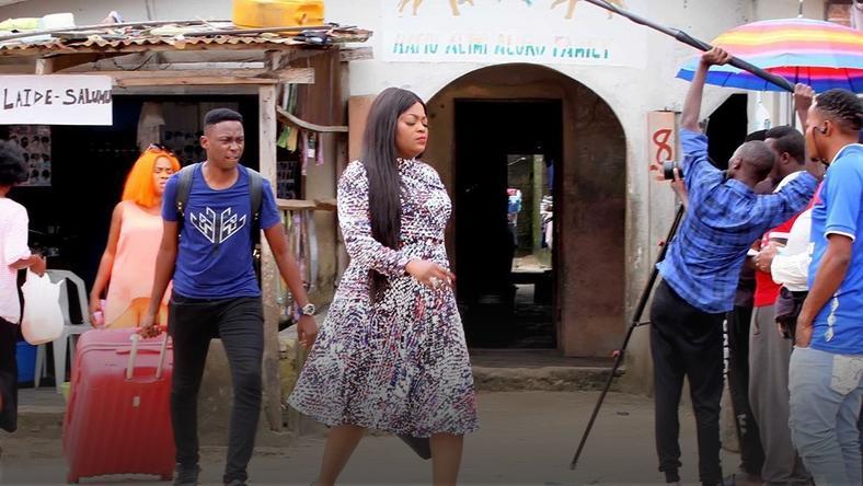 Jenifa and Timini on the set of 'Aiyetoro town' [Instagram/officialaiyetorotown]