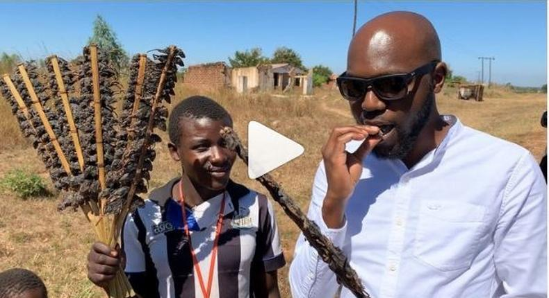 Larry Madowo eating Mouse