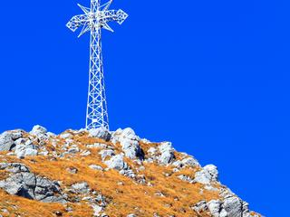 Poland, Tatra Mountains, Zakopane - south slope of the Giewont peak with its historical cross at the top