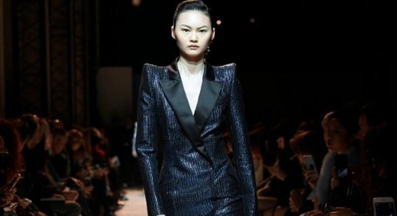 A model wearing one of Mugler's fearsome power suits
