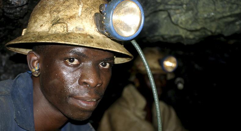 Hagai Sichone, of Konkola Copper Mines PLC, works underground in Nchanga mine in Cingola, in this April 13, 2005 file photo.