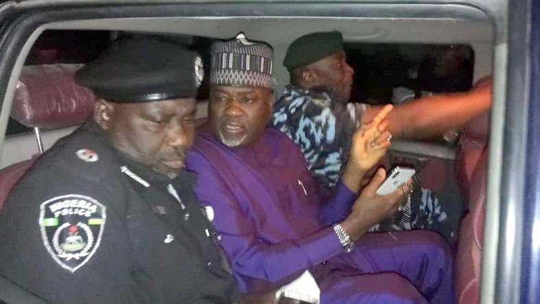 Kano State deputy governor, Nasir Gawuna (middle), flanked by police officers
