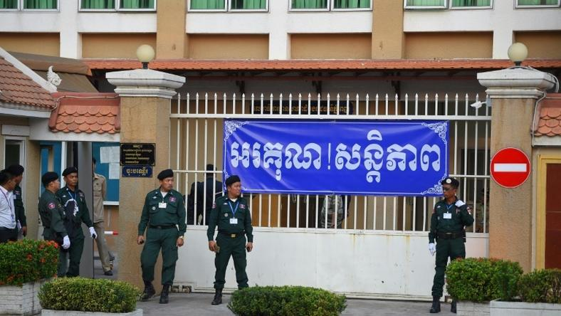 Police officers surrounded Phnom Penh Court on Wednesday as Cambodian opposition leader Kem Sokha arrived for his treason trial