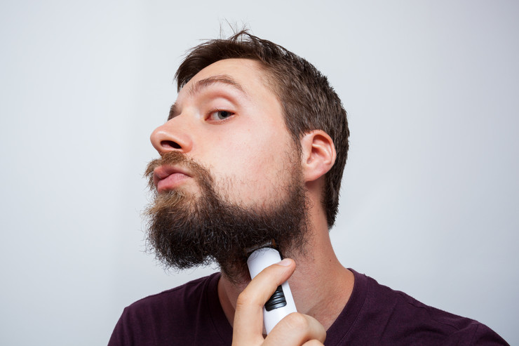 stock-photo-young-bearded-man-trimming-his-raunchy-beard-745125220