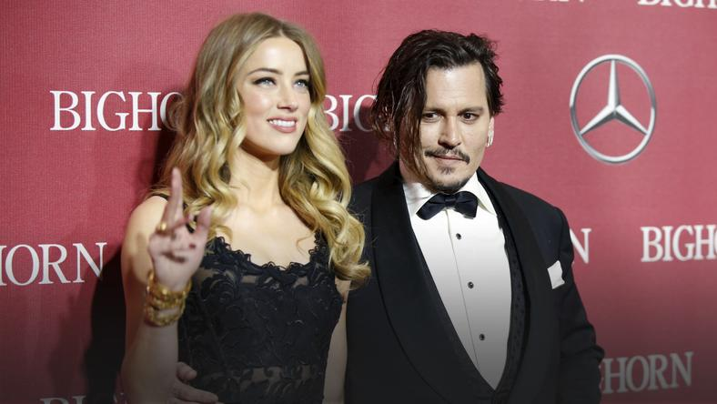 Desert Palm Achievement Award recipient actor Johnny Depp and wife actress Amber Heard pose at the 27th Annual Palm Springs International Film Festival Awards Gala in Palm Springs