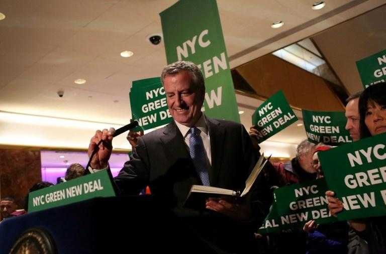 Mayor Bill De Blasio arrives at a Green New Deal rally at Trump Tower in New York on May 13