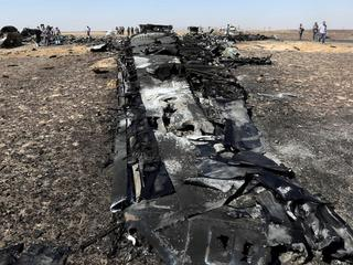 Military investigators from Egypt and Russia stand near the debris of a Russian airliner at the site