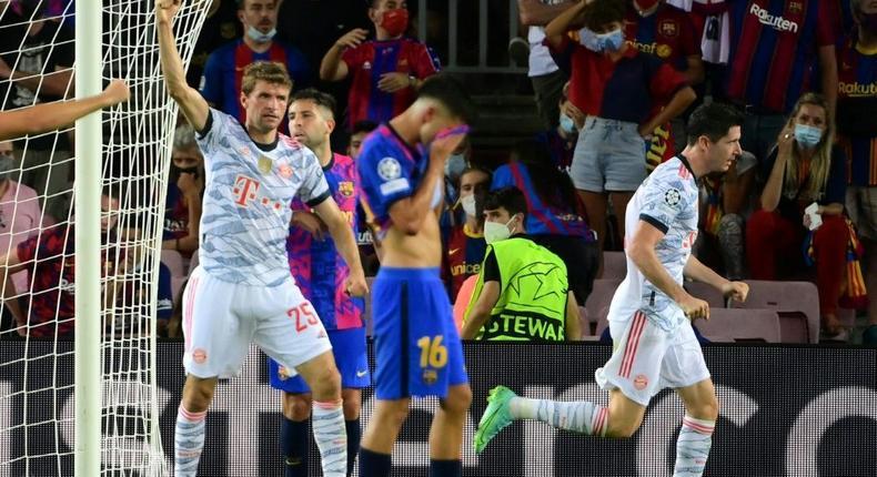 Robert Lewandowski (R) and Thomas Mueller (L) both scored at Camp Nou on Tuesday in Bayern Munich's 3-0 away victory Creator: LLUIS GENE